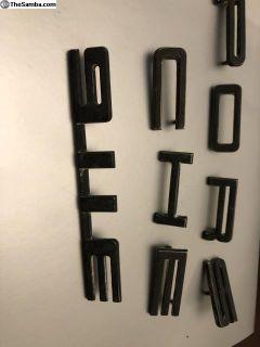 911e emblem script and letters