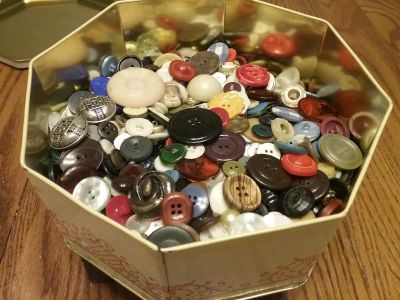 Metal tin with vintage button collection