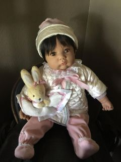 Sweet baby doll with toy rabbit