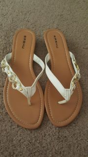 Gold and white sandals