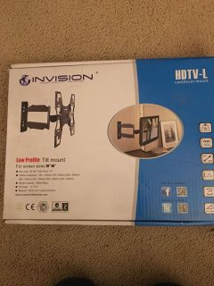 New in box TV mount swivels and tilts