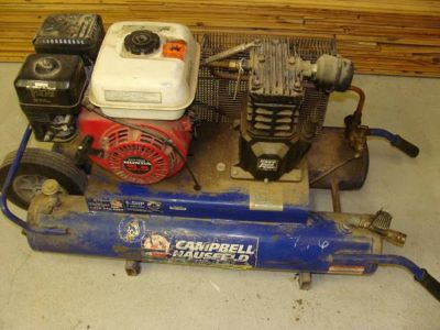 Wheelbarrow compressors, lazer level and Sheetrock lift (Lacy Lakeview)