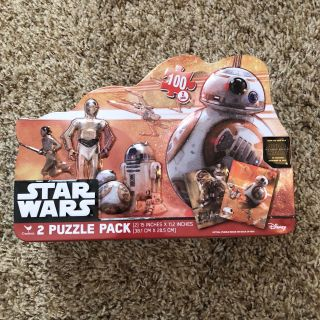2 Star Wars puzzles (unopened/sealed) in a tin