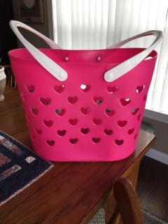 Rubber storage basket with movable handles