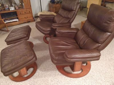 Two brown leather recliners