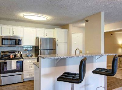 Impressive Remodel, All-Season Pool, Walk To Shopping and Dining!