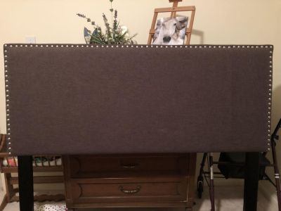 Queen size headboard. Chocolate colored fabric. Great condition