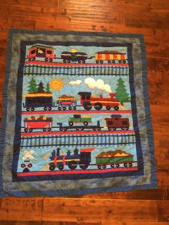 Baby quilt, train theme. Machine stitched . Perfect condition. Smoke free home.