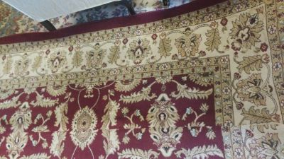 Two separate area rugs one 8 by 9 the other 8 by 11