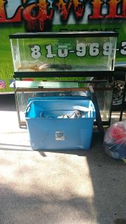 Fish tanks, stand and big tub of supplies all for $20.00