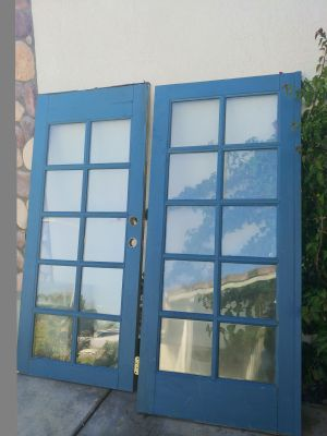 French doors. Solid wood. Beautiful doors used to be on a 3 million dollar home. So they're the highest quality