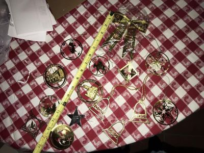 14 metal ornaments and one large bow metal ornament