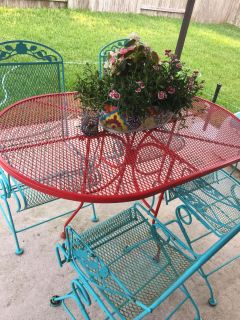 Wrought iron painted Patio table and 4 chairs.