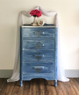 Four drawer antique waterfall style blue and silver dresser