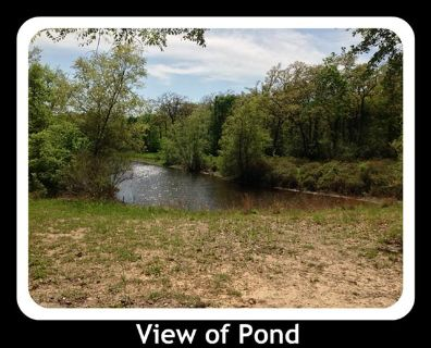 Wooded lot on Pond  close to Lake Limestone wall utilities and RV