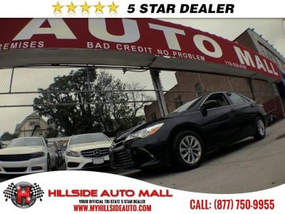 2016 Toyota Camry 4dr Sdn I4 Auto LE (Natl) (Midnight Black Metallic)