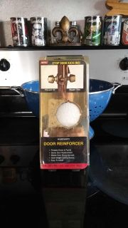 """New in package. High security, Door reinforcement, solid polished brass. Fits the width of a 1 3/8"""" door. Asking $2.00"""
