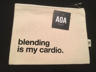 AOA canvas cosmetic case, new with tags. Approximately 9 x 7 . Great quality!