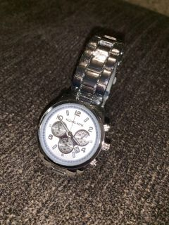 Brand new Michael Kors watch. Works!! It s brand new , still wrapped. Price firm