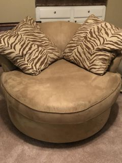 Swivel Chair, brown couch and pillows