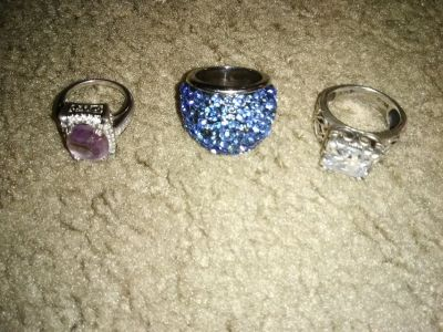 2 Real silver rings and one costume jewelry ring.