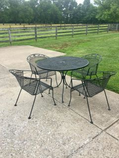 WROUGHT IRON PATIO TABLE & CHAIRS ! Price is for all 85.00