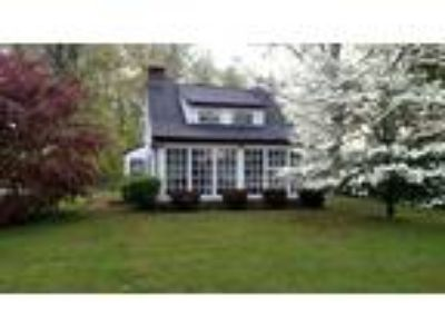 What a charming spot! It is opposite Pinch Pond Family Campground and over the