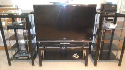 52 in Toshiba TV 1 year old with entertainment center