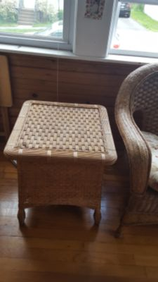 Wicker couch with cushion, and wicker end table .