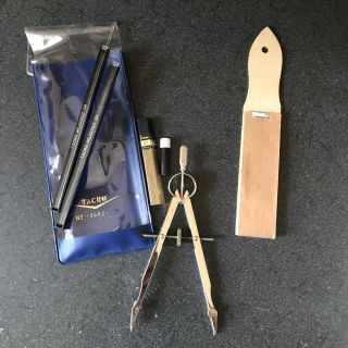 Drafting tools with compass