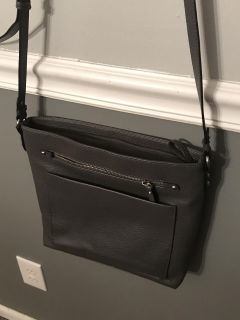 Grey purse w/ pockets on the front and back