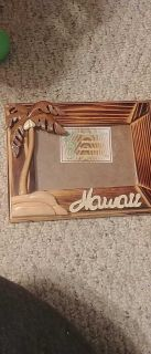 Wooden Hawaii picture frame. Beautifully carved.