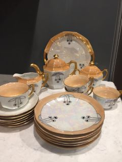 Tea set from Germany. Teapot, creamer, sugar bowl, 4 cups and saucers, 6 Dessert plates, 1 cake plate