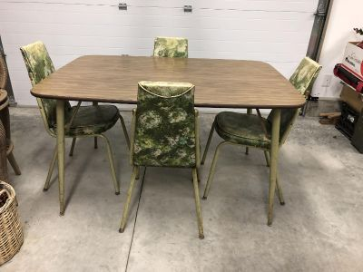 Vintage kitchen table and chairs. Good condition. Chairs are faded in spots, not torn.