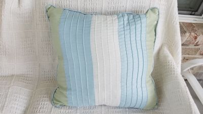 Throw pillow. Cover is not removable. Brand unknown.