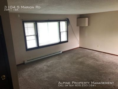 2 Bed/1 Bath Duplex with Attached Garage and In Unit Laundry!!