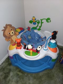 Baby Einstein saucer/bouncer plays music like new excellent condition