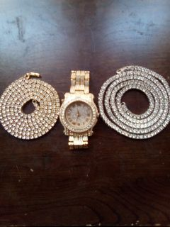 Gold and white gold tennis necklace and gold watch