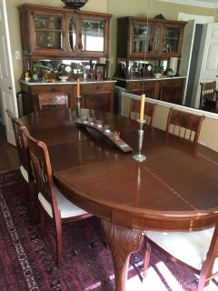 Antique crank style walnut dining table with two leaves, 6 chairs and a china hutch
