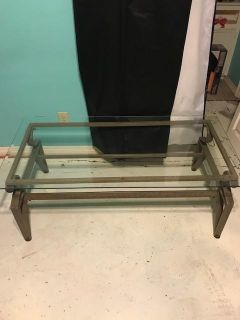"""Glass top coffee table. Heavy metal frame. Very good condition. 18"""" tall x 47.5"""" long x 24"""" wide"""