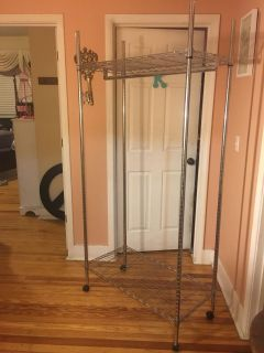Metal clothes rack on wheels