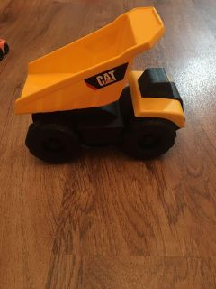 CAT dump truck toy. In good condition. Asking $3