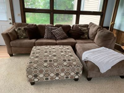 Full size pull out/sectional couch with ottoman and pillows