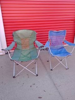 2 folding out door chairs