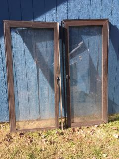 Two Storm Doors. Dimensions: 32 x 80.75 inches each