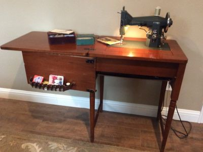 Kenmore sewing machine with wood cabinet