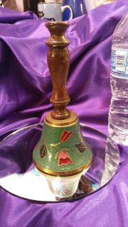 Brass and enameled bell w wood handle.