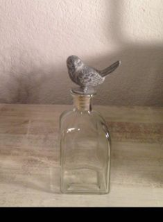 Decorative glass bottle with bird stopper