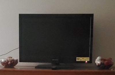 """32"""" TV with remote."""