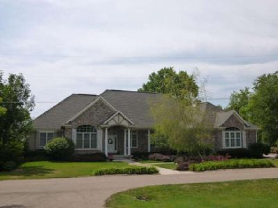 $719,900 Hilbert 4BR, Vacation year around in this custom crafted